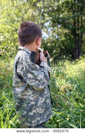 Young Boy Outside Sighting In A Rifle