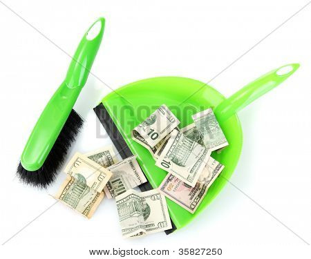 Sweeps money in the shovel on white background close-up