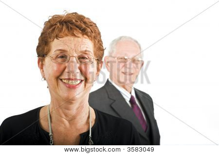 Senior Businesswoman And With Colleague In The Background