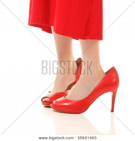 little fashion girl in mother's red dress and shoe's on high heels, isolated on white background