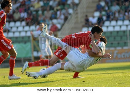 KAPOSVAR, HUNGARY - AUGUST 4: Bojan Vrucina ( in white) in action at a Hungarian National Championship soccer game Kaposvar (white) vs Debrecen (red) on August 4, 2012 in Kaposvar, Hungary.