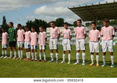 KAPOSVAR, HUNGARY - JULY 21: Tirgu Mures team before the VIII. Youth Football Festival U14 match Tirgu Mures (pink) (ROM) vs. Kaposvar (green)(HUN) on July 21, 2012 in Kaposvar, Hungary
