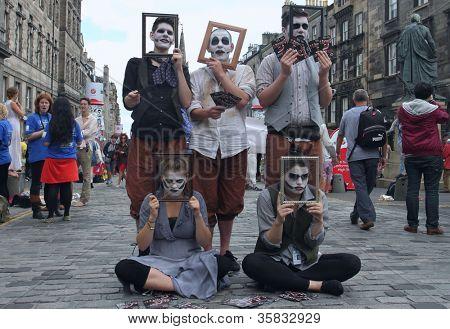 EDINBURGH- AUGUST 11: Members of Minotaur Theatre Company publicize their show Oedipus during Edinburgh Fringe Festival on August 11, 2012 in Edinburgh