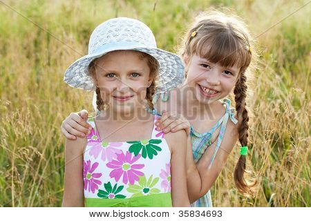Two girls - girlfriends in summer dresses