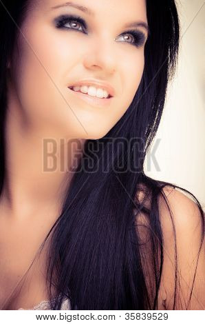 Closeup photo of a beautiful girl with black hair