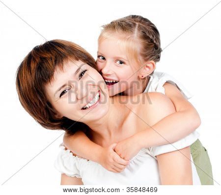 beautiful little girl embraces mother for shoulders