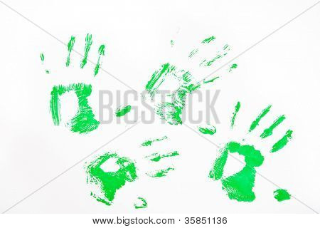 Four green hand prints against a white background