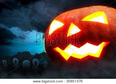 Halloween decoration - a graveyard with a pumpkin in the night