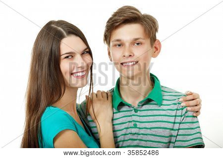 Portrait of young cheerful sister and brother over white background. Caucasian teens