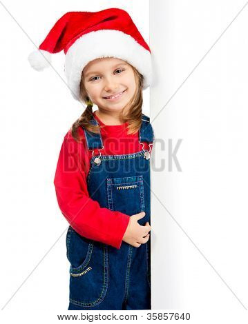little girl in santa hat behind the board