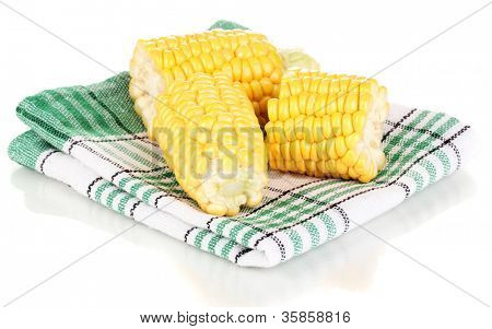Fresh corn pieces on napkin isolated on white