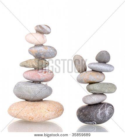 Stacks of balanced stones isolated on white