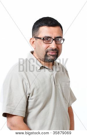 Handsome And Intelligent Middle Aged Mature Indian Adult Business Man Looking Thoughtfully And Very