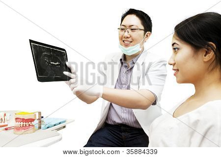 Dentist Shows X-ray To His Patient