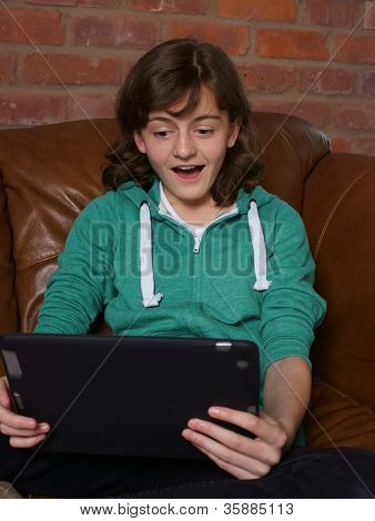 Teenager Looking At Tablet Computer