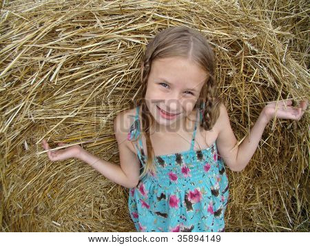 Girl On Straw Bail