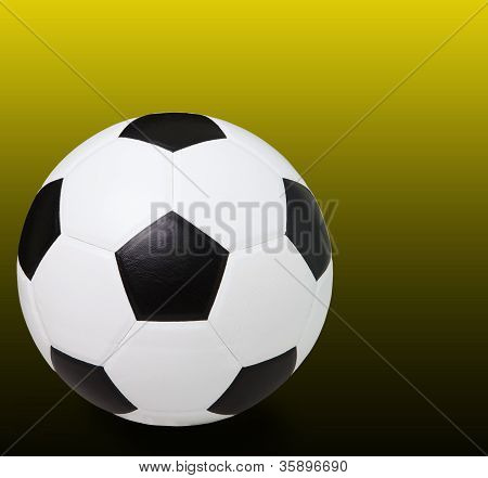 soccer football on dark yellow background