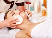 stock photo of beauty parlour  - Young woman getting facial  massage in beauty spa - JPG