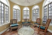 Sunroom in luxury home with terra cotta floors