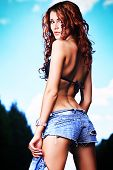 stock photo of bosoms  - Shot of a sexy woman posing outdoor - JPG