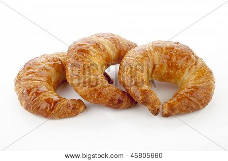 3 tasty croissants over white background
