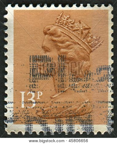 UK-CIRCA 1984:A stamp printed in UK shows image of Elizabeth II is the constitutional monarch of 16 sovereign states known as the Commonwealth realms, in Pale Chestnut, circa 1984.