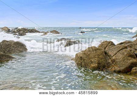 beautiful stones in the waves on ocean coast
