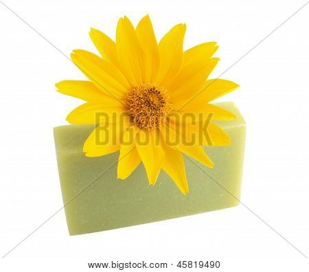 Yellow Flower And Green Soap On White