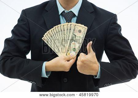 Businessman holding money isolated over white background