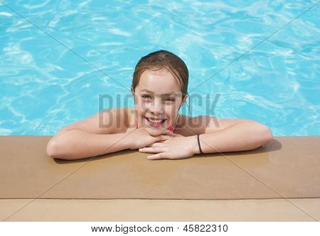 Girl enjoying her summer vacation at the Pool