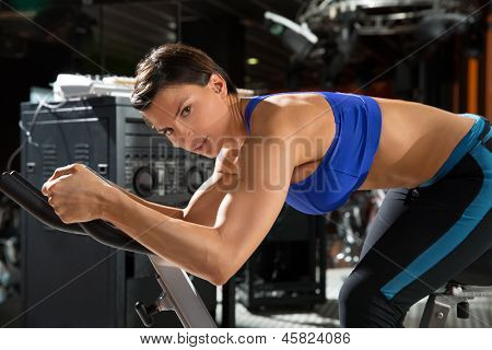 Aerobics monitor trainer woman at gym at trainning class