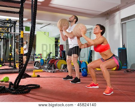 ball fitness workout group woman and man at gym