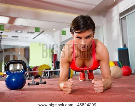 Crossfit fitness woman push ups elbow forearms pushup exercise
