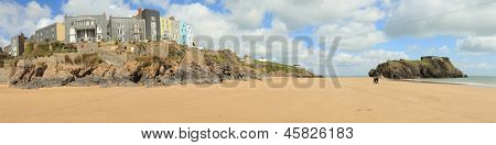 The main beach at Tenby, in West Wales, with its row of Victorian or Edwardian era hotels looking out from The Esplanade over the sands and the small island topped with an old fortification