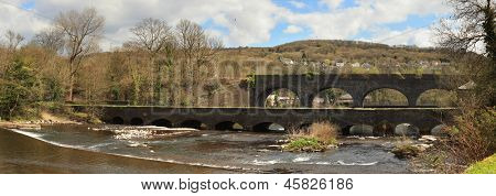 Aberdulais aquaduct and railway viaduct, over the River Neath in South Wales, UK. The 130m canal aqueduct  is the longest in Sout Wales, it was built in 1820.