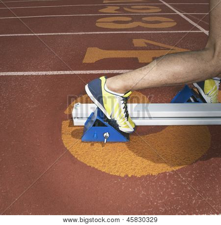 Athletes feet in starting blocks
