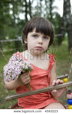Litle Girl Sitting On Swing