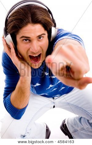 Top View Of Shouting Male Enjoying Music And Pointing