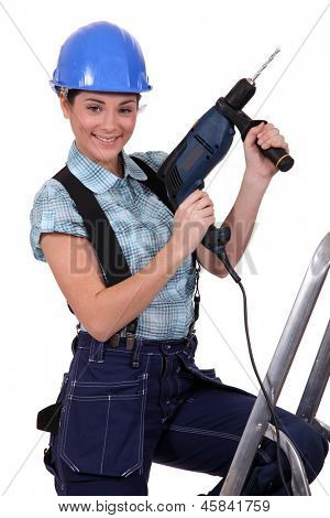Tradeswoman holding a power tool