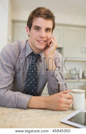 Man drinking a coffee at morning in kitchen
