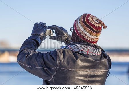 A Man Taking A Picture