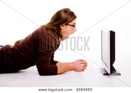 Side Pose Of Shocked Man Looking At Screen