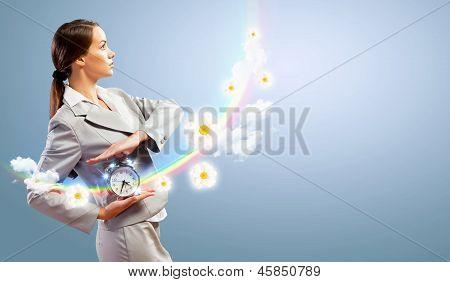 Empresaria holding alarmclock