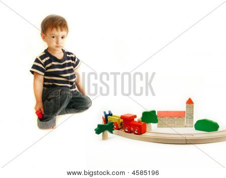 Toddler Playing With Wooden Train