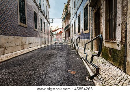 Narrow Street In The Midieval Alfama District Of Lisbon, Portugal