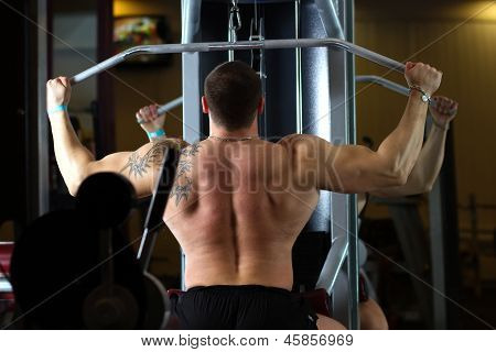 Pumped Man Pulling Weight In Gym