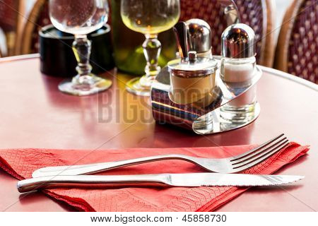 table setting - plate, knife and fork on table