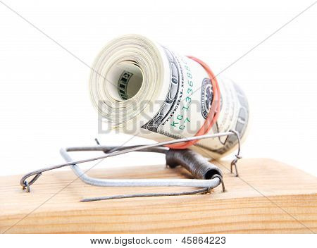 Dollars Roll In A Mousetrap As Concept Of Money Security Or Bait
