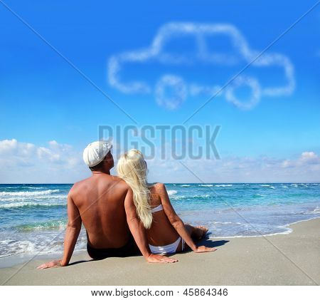 Young Couple On Sea Sand Beach Dreaming About The Own Car