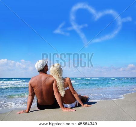Love Concept - Couple On Sea Beach Look At Cloudy Heart